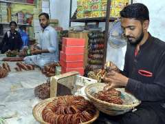 HYDERABAD: Workers busy in arranging Bangles at Bangle Market in preparation for Eidul Fitr.