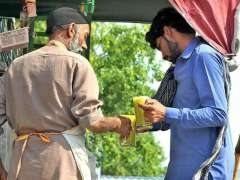 ISLAMABAD: A vendor selling sugarcane juice at his roadside setup in Federal Capital.