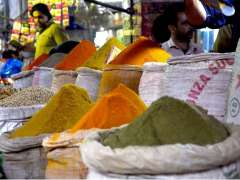 LAHORE: A shopkeeper displaying the different kind of spices to attract the customers in a local market.