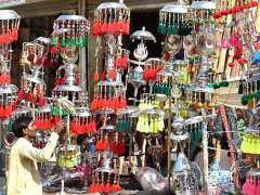 LARKANA: A vendor arranging and displaying the Muharram related stuff at Jafri Imambargah during Holy Month of Muharramul Harram.