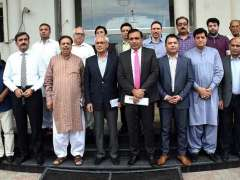 SIALKOT: A group photo of representative of Akhuwat Dr. Amjad Kamran during signing of MOU of Akhuwat College at SCCI.