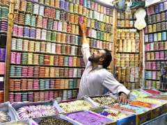 RAWALPINDI: A shopkeeper displaying colorful bangles to attract the customers in preparation of upcoming religious festival Eidul Fitr.