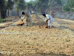 MULTAN: Labourers busy in construction work of Basti Maharan Road during development work in the city.