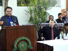 LAHORE: Federal Minister for Information and Broadcasting Fawad Chaudhry talking to media persons.