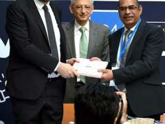 PARIS: Executive Director of Campus France Thierry Valentin giving a memento to Dr. Arshad Ali of HEC.