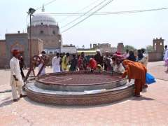 MULTAN: Visitors viewing historical well outside shrine of Hazrat Bahauddin Zakariya.