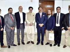 ISLAMABAD: Chairman Senate, Muhammad Sadiq Sanjrani in a group photo with the Chinese delegation at Parliament House.