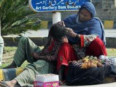 MULTAN: A gypsy lady vendor with her daughter while sitting at Qasim Park at a slum area in Provincial Capital.