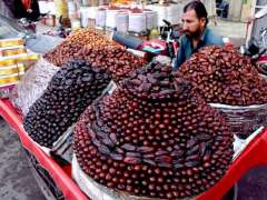 LAHORE: A shopkeeper displaying the different kind of dates to attract the customers in a local market.