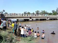 SIALKOT: A large number of people gathered at a canal to get some relief in the scorching weather.