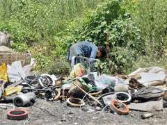 ISLAMABAD: A gypsy person searching valuables from vehicles scrap to support his family in Federal Capital.