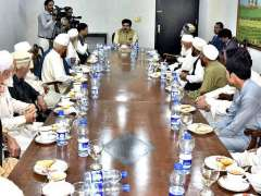 ISLAMABAD: Chairman Senate, Muhammad Sadiq Sanjrani exchanging views with FATA delegation at Parliament House.