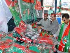 MULTAN: Shopkeeper displays flags of different political parties ahead of upcoming General Election 2018.