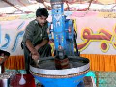 MULTAN: A vendor preparing traditional summer drink at his roadside setup.