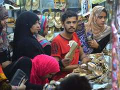 HYDERABAD: Ladies selecting and purchasing footwear in connection with upcoming religious festival Eidul Fitr.