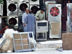 RAWALPINDI: Vendors displaying room-coolers to attract the customers in a local market.