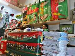 LAHORE: Shopkeeper displays flags of different political parties ahead of upcoming General Election.