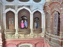 CHINIOT: A couple from Australia Tricia Blombery and Stuart Grigg visiting Wooden Palace Umar Hayat.
