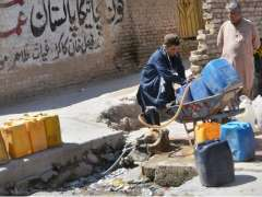 QUETTA: Men filing their canes with clean water from tub well. Quetta needs 45m gallons but is receiving 28m gallons.