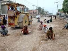 MULTAN: Labourers busy in construction work of Nawan Shaher to Dera Adda Road.