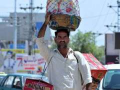 RAWALPINDI: A vendor displaying different items to attract the customers while shuttling in Federal Capital.