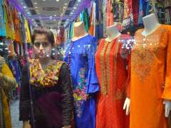 HYDERABAD: A lady selecting and purchasing dresses in connection with upcoming religious festival Eidul Fitr.