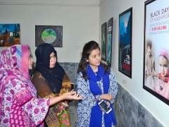 HYDERABAD: Visitors viewing the displayed stuff during two days photos & art exhibition in connection with Black Day of Kashmir at Mehran Arts Council.
