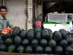 ATTOCK: A vendor showcasing watermelons in the local market.