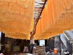 LAHORE: A labourer spreading vermicelli for drying purpose at his workplace for upcoming Eid-ul-Fitr.