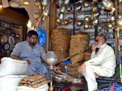 LAHORE: A shopkeeper displaying smoking related stuff at his shop to attract the customers.