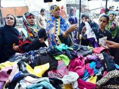 HYDERABAD: Ladies selecting and purchasing old warm clothes displayed by vendors at Cloth Market Road.