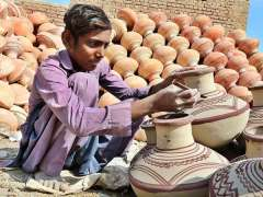HYDERABAD: A young artisan busy in paint the clay-made pots at Kumbhar Para.