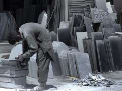 RAWALPINDI: A worker busy in grinding marble at his workplace.