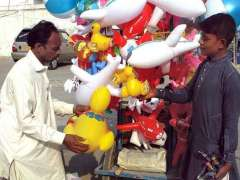 BAHAWALPUR: A disabled person is selling children's toys on his cycle.