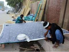 MULTAN: Workers preparing traditional curtain (chic) at their roadside workplace.