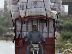 MULTAN: A view of overloaded tricycle rickshaw on the way may cause any mishap.