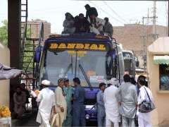 SARGODHA: People sitting on the rooftop of a bus due to shortage of transport at bus stand to reach their hometown to celebrate Eidul Fitr with their relatives.