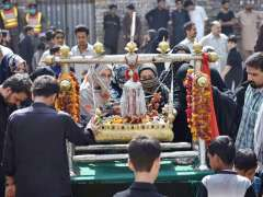 PESHAWAR: People perform rituals during the 9th Ashura Procession of Muharramul Harram in the provincial capital.