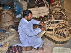 LAHORE: A worker busy in making traditional hand-made furniture at his shop to attract the customers.