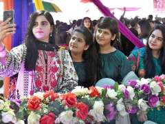LARKANA: Students taking selfie with cell phone during opening ceremony of Food Festival-2018 at SZABIST Intermediate College.