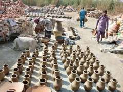 HYDERABAD: A craftswoman busy in preparing clay-made pots at Kumbhar Para.