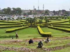 LAHORE: PHA staffers busy in trimming plants in a local park in the city.