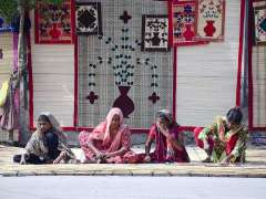 HYDERABAD: Lady labourers preparing traditional curtains (chick) on their roadside setup at Radio Pakistan Road.