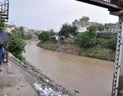 راولپنڈی: شہر میں ہونے والی موسلا دھار بارش کے دوران نالہ لئی سے سیلابی ..