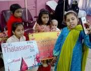 حیدر آباد: تھیلیسیمیا کے عالمی دن کے موقع پر متاثرہ بچے سیلفی لے رہے ..