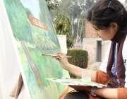 لاہور: ایک طالبہ الحمراء قذافی سٹیڈیم میں مقابلے کے دوران پینٹنگ تیار ..