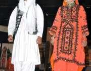 اسلام آباد: میوزیم لوک ورثہ میں ماڈلز کا ایک انداز۔
