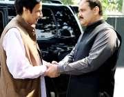 لاہور: وزیراعلی پنجاب سردار عثان بزدار اور قائمقام گورنر پنجاب چوہدری ..