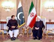 تہران: وزیر اعظم عمران خان اور صدر حسن روحانی ملاقات کے دوران تبادلہ ..