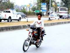 ISLAMABAD: A teenage boy riding motorcycle with wearing safety helmet and needs the attention of concerned authorities.